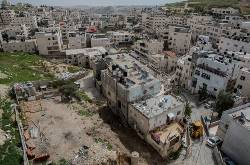Palestinians forced to demolish own homes
