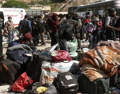 Families leaving Eastern Ghouta take prize possessions